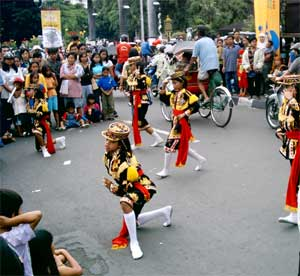 Children dancing on malioboro street.